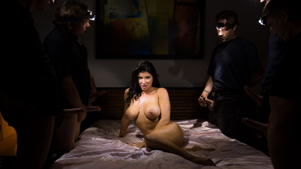 JulesJordan.com - Romi Rain Home Invaders Come To Prowl, She Rewards Them With An Open Mouth.
